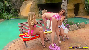Gorgeous babes in threesome lesbian action near the pool