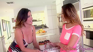 Busty lesbians having fantastic sex action in a kitchen