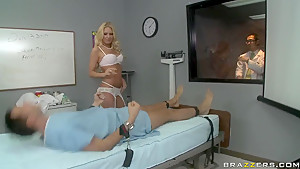 Ill Keiran Lee gets his treatment from hot doctor Riley Evans