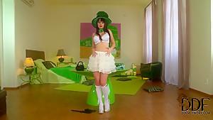 Woman in green hat Antonia shuffles her tokis