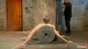 Sexy brunette experiences nipple torture, brutal crotch rope and extreme bondage.