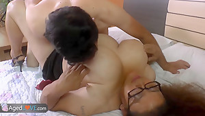 Chubby brunette with huge tits is getting fucked by horny man on bed