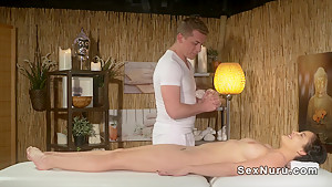 Masseur bangs hairy cunt babe from behind