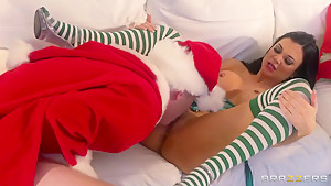 Hot brunette babe swallows Santa's gigantic erected cock