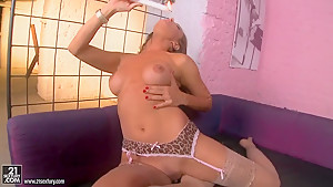 Wild Sandy in lingerie dances around pole