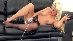 Stacked blonde in black stockings Holly fucks a big cock with fervor
