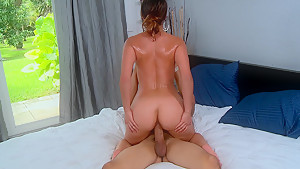 Young latina sliding on a cock